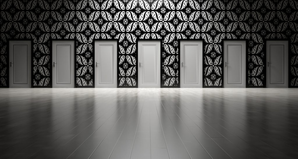 7 closed white doors in a wall