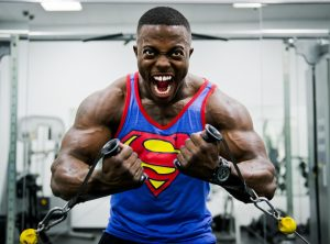 strong man in superman shirt working out