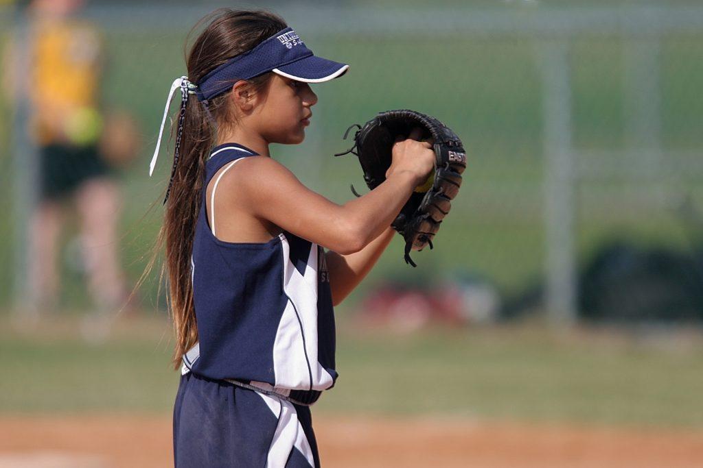 female youth softball pitcher