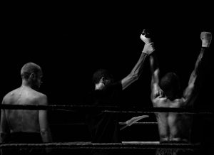 winner being announced in a boxing ring
